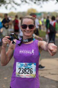 Brooke at 2016 Marine Corps Marathon with Finishers Medal